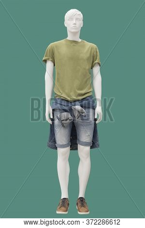 Full Length Male Mannequin Dressed In Short Sleeve Shirt And Jeans Shorts, Isolated. No Brand Names