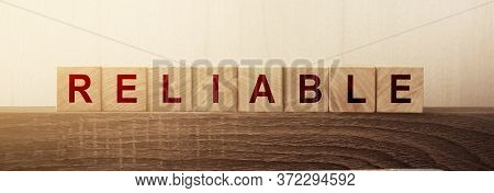 Reliable Word On A Wooden Blocks. Trust Worthy Business Or Personal Concept