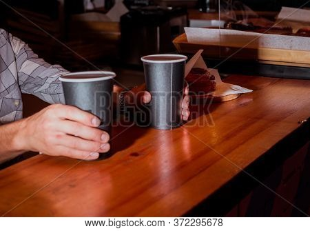 Americano In Cup With Sugar Bun. Soft Focus