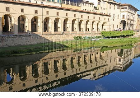 Reflection On The Arno River Of The Famous Vasari Corridor Is A Building That Connects The Uffizi Mu