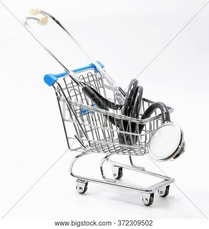 Stethoscope On A Shopping Cart Symbol Of Health Care Spending On The White Background