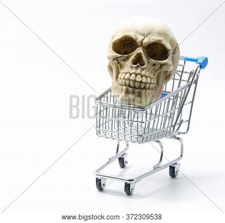 Human Skull With Teeth On A Shopping Cart And White Background