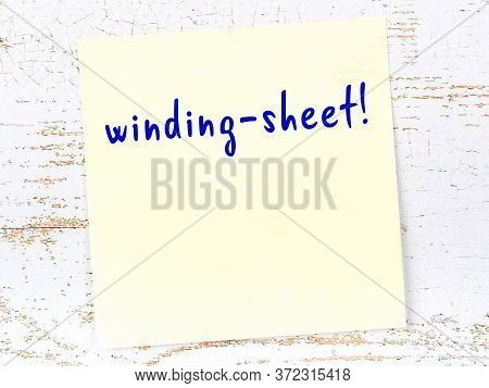 Concept Of Reminder About Winding-sheet. Yellow Sticky Sheet Of Paper On Wooden Wall With Inscriptio