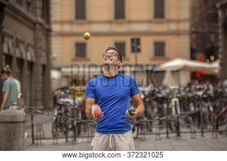 Bologna, Italy 17 June 2020: Street Artist Juggler In Bologna, Italy
