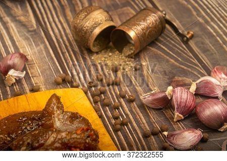 Marinated Meat On A Cutting Board, Garlic, . Close Up.