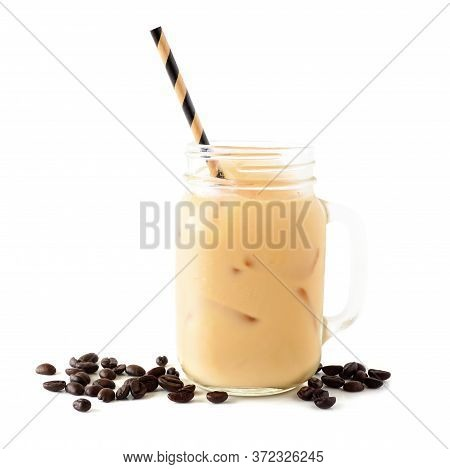 Cold Summer Iced Latte In A Mason Jar With Coffee Beans Isolated On A White Background