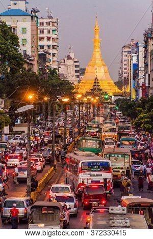 Yangon, Myanmar - December 15, 2016: Traffic On Mahabandoola Road Leading To Sule Pagoda In Yangon.