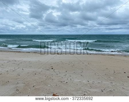 Ocean Waves Lapping On The Beach  On A Beautiful Sunny Day Along The Shoreline On North Hutchinson I