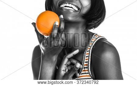 Portrait of a Happy Cheerful African American Woman. Healthy Food. Isolated on White Background. Dental Care. Black Female With Perfect White Teeth.