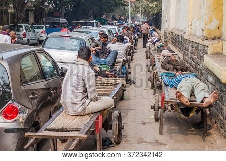 Delhi, India - January 24, 2017: Cart Pullers Rest On A Street In Delhi.