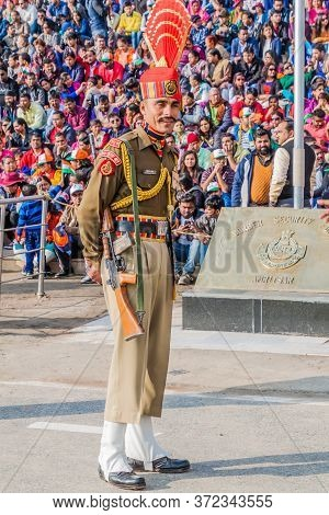 Wagah, India - January 26, 2017: Border Guard Watched By Indian Spectators At The Military Ceremony