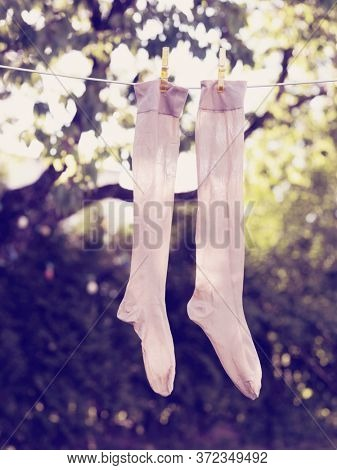 Pair of socks drying on clothesline