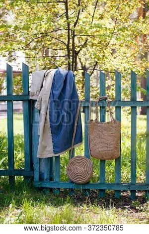 A Raincoat And Wicker Tarts In The Park Hang On The Fence, A Soothing, Calming Atmosphere, Tranquili