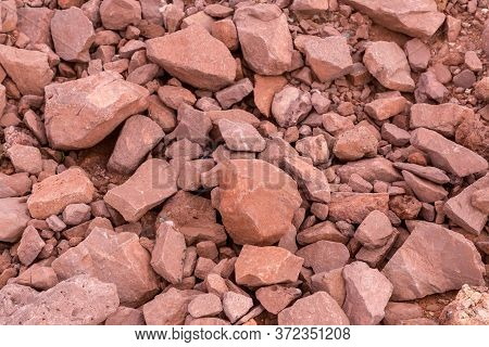 Rouge Rock For Road Reclamation Work. Laterite Pattern. Lateritic Soil Textured Background. Backgrou