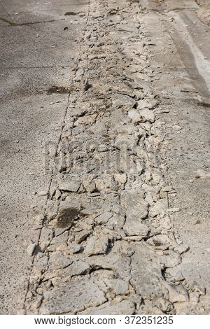 Broken Road Crack Texture. After Construction Drilled Surface With Jackhammer. Concrete Broken From