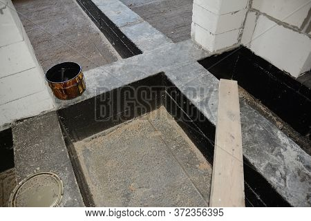 A Close-up On Waterproofing, Damp Proofing Flooring With Bitumen Paint Spray, Liquid Rubber Foundati
