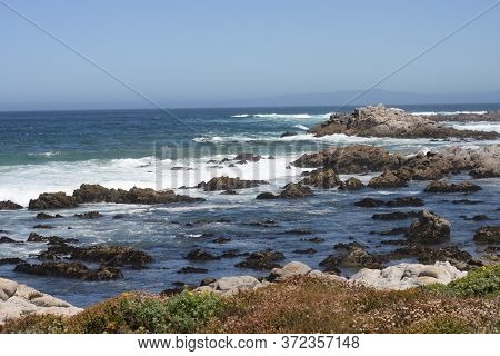 This Is An Image Of Costal Waves And Rocks Taken At Asilomar State Beach In Pacific Grove, Californi