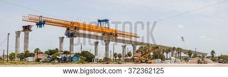 View Of Large Crane Building A Large Bridge In Corpus Christi, Texas, Usa