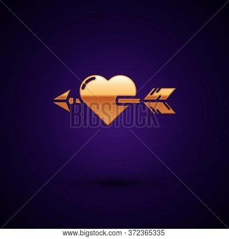 Gold Amour Symbol With Heart And Arrow Icon Isolated On Dark Blue Background. Love Sign. Valentines