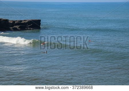 Surfer On The Wave, Catches A Wave, Surfing In The Pipe. Surfing In The Ocean On The Island Of Bali,
