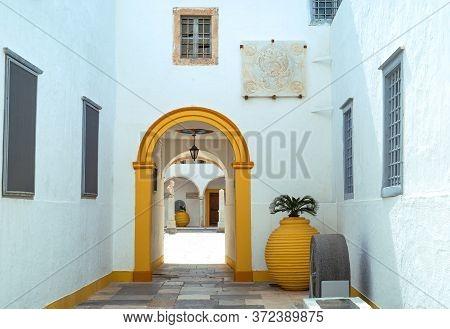 Hydra, Greece -  March 17, 2018: The Entrance To The Monastery Of Santa Maria Assunta