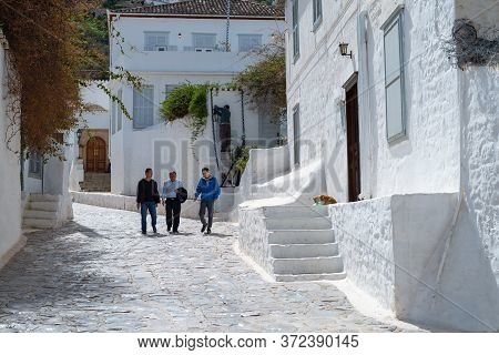 Hydra, Greece -  March 17, 2018: Local People Walking In The Village Of The Island