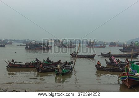 Myeik, Myanmar-February 8,2020. Busy Burmese seaport south of the country on the coast of the Andaman Sea.It is a gateway to the 800 offshore islands of the Mergui Archipelago.Foggy day in the city