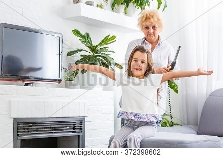 Adorable Playful Little Child Girl With Happy Middle Aged Nanny Grandma At Home. Cute Small Preschoo