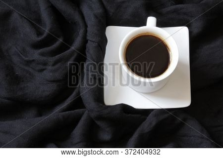 Home Cozy Composition. Cup Of Coffe On Black Background. Cozy Background. Flat Lay, Top View, Copy S