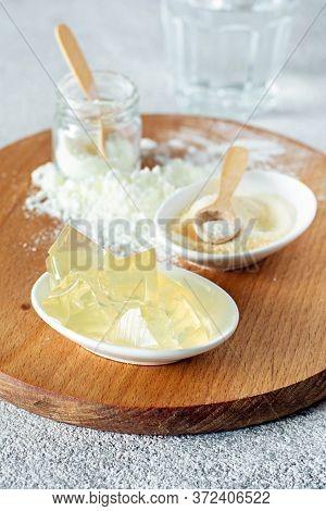 Products (collagen Powder, Gelatin, ) Which Contain Collagen. Collagen Powder On A Light Background.