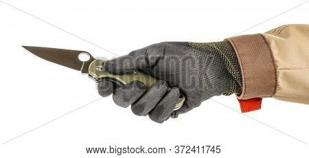 Worker Hand In Black Protective Glove And Brown Uniform Holding Open Pocket Folding Knife With Dark