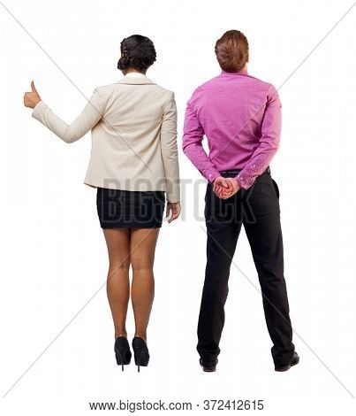 Back view of business couple in suit showing thumbs up. businessman and businesswoman. Rear view people collection. backside view of person. Isolated over white background.