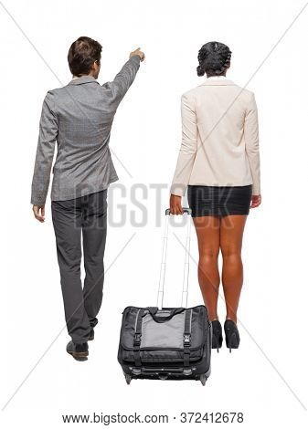 Back view of  two business people in suit pointing. Business team. traveling with suitcas. Back view. Rear view people collection. backside view of person. Isolated over white background.
