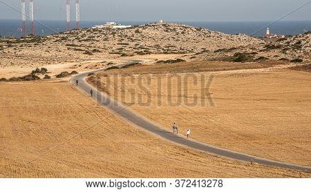 Cape Greko, Cyprus, June 08 2020: Tourist People Trekking On A Road At Cape Greko Peninsula Paralimn