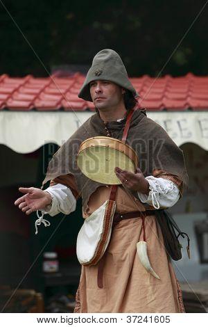 Portrait Of A Troubadour On Stilts