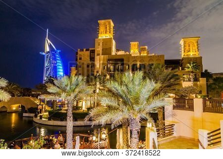 Dubai, Uae - March 11, 2017: Night View Of Burj Al Arab Tower Of The Arabs Seen From Madinat Jumeira