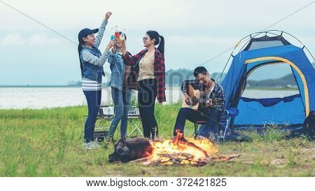 Camping Outdoor. Group  Friends Camping Leisure And Destination Travel. Family Sitting Around Camp F