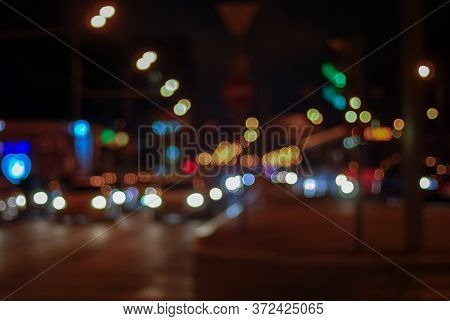 Blurry Traffic Lights Of Nighttime City, Dark Blurred Cityscape With Bokeh