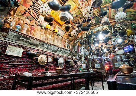 Isfahan, Iran: Interior Of Historical Persian Tea House With Old Carpets, Vintage Arts And No People
