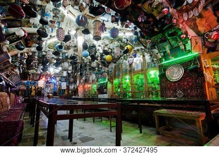 Isfahan, Iran: Interior Of Historical Persian Tea House With Old Teapots, Carpets, Vintage Arts, Ant
