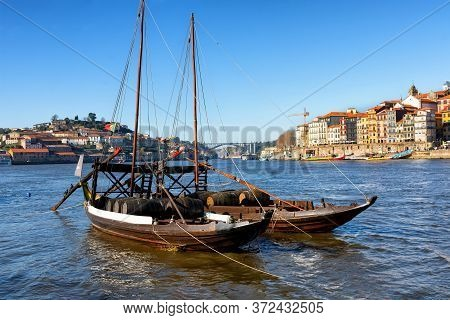 View Of Douro River And The City Of Porto, Large Boats With Barrels Of Wine - Port, The Most Famous