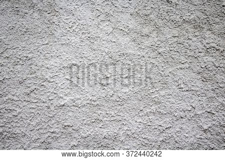 Gray white color, plaster rough texture background, building facade wall grunge material