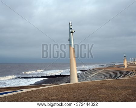 The Curved Promenade Along The Seafront At Cleveleys In Blackpool With Steps Leading To The Beach Wi
