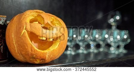 Alone Halloween Smiling Pumpkin On Shelf With Glasses