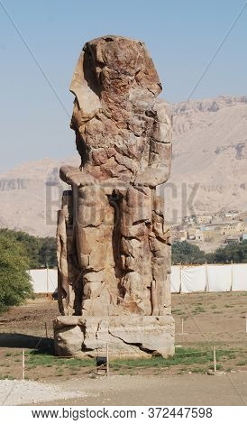 Colossus Of Memnon In Luxor. Big Statues Near The Valley Of Kings. Egypt
