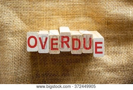 Wooden Blocks Form The Word 'overdue' On Beautiful Canvas Background. Business Concept.