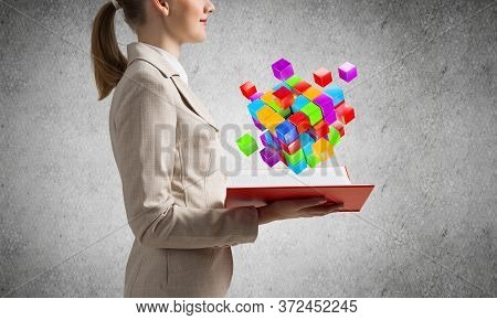 Woman Showing Colorful Geometric 3d Cubes Composition Above Open Book. Digital Technology And Innova