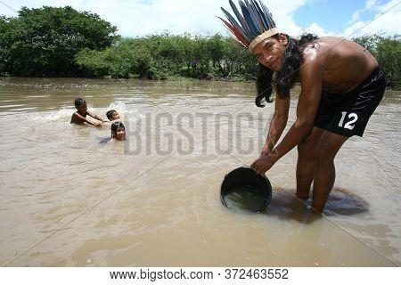 Itaju Do Colonia, Bahia / Brazil - November 29, 2011: Chief Akanawa Shows Water Consumed By Indigeno