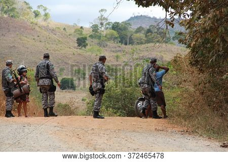 Pau Brasil, Bahia / Brazil - May 3, 2012: National Force Military Personnel Approach Vehicles And Pe