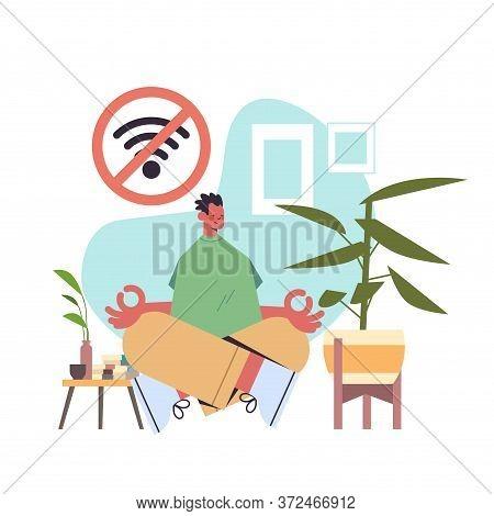 Man Sitting Lotus Pose And Meditating Digital Detox Offline Activities Concept Guy Spending Time Wit